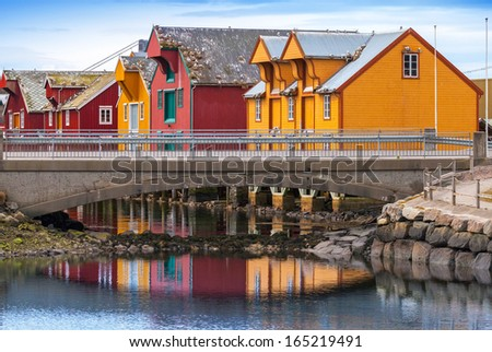 Norwegian village with colorful wooden houses on the coast
