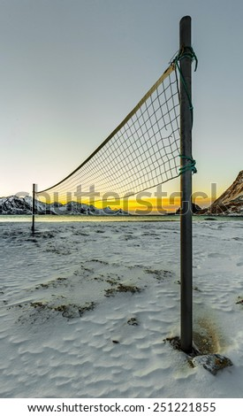 Norwegian volleyball. Playground on the beach on Lofoten islands at sunset, Troms county - Norway