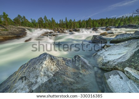 Norwegian waterfall in the Northern province - stock photo