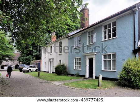 NORWICH, UK - JUNE 11, 2016. A secluded row of ancient town cottages at Ferry Lane, between the cathedral and the River Wensum, at Norwich in the county of Norfolk, England, UK.