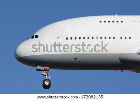Nose of huge landing plane - stock photo