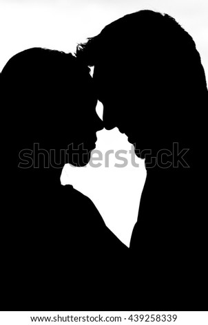 nose to nose smiling man silhouette couple in white background
