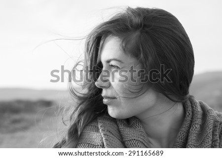 Nostalgia. Black and white portrait of a wistful young woman. - stock photo