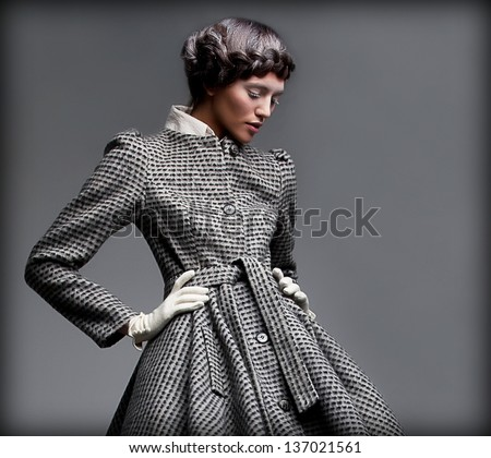 Nostalgia. Romantic Lady in Classic Coat Daydreaming. Pinup Style - stock photo