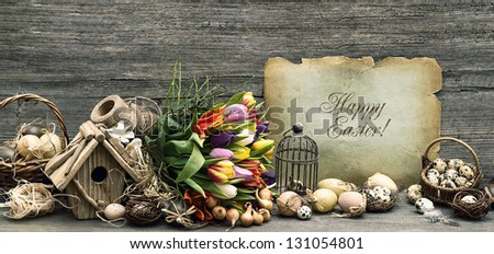 nostalgic easter decoration with eggs and tulip flowers. vintage style still life. home interior - stock photo