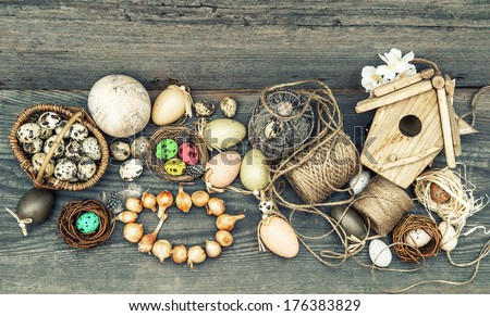 nostalgic easter still life home interior. vintage decoration with eggs and flower bulbs on wooden background. retro style toned picture - stock photo