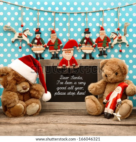 nostalgic home christmas decoration with antique toys. vintage arrangement  and blackboard with sample text Dear Santa - stock photo