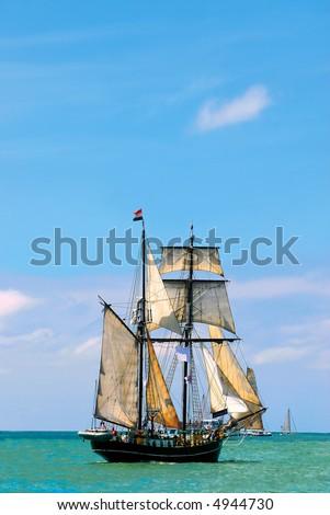 nostalgic pirate-ship sailing the caribbean on a sunny day - stock photo