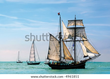 nostalgic pirate-ship sailing the caribbean on a sunny day - stock photo