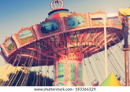 Nostalgic street fair ride in subtle vintage tones - stock photo