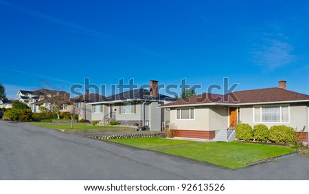 Not brand new houses but , very nice looking  neighborhood in sunny day. Vancouver, Canada. - stock photo