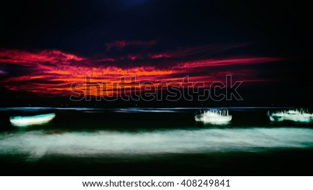Not clear abstract night landscape, blur in motion. Ocean boat in a storm. Long exposure. - stock photo