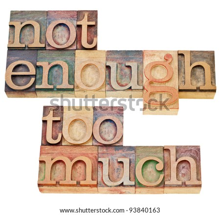 not enough, too much - supply and demand or consumerism concept - a collage of isolated text in vintage wood letterpress printing blocks