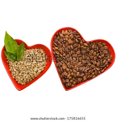 not ground coffee beans, black and green in a bowls in the shape of a red heart  isolated on white background  - stock photo