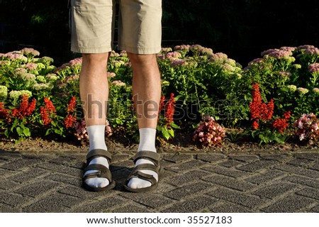 Not so sexy! White socks in sandals - stock photo