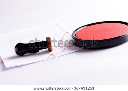Notary public stamp, document, stamp pad on white background with reflection. Red ink - stock photo