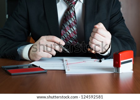 Notary public stamping an act of attorney - stock photo