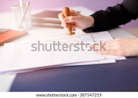 Notary Public stamping the document. Law office concept.  - stock photo