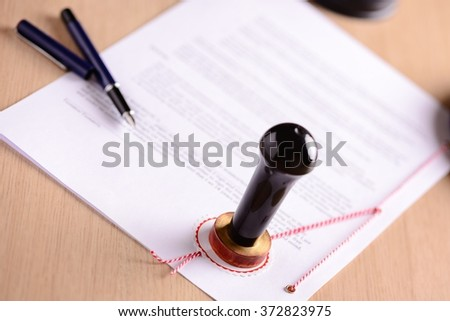 Notary's public pen and  stamp on testament and last will. Notary public tools - stock photo
