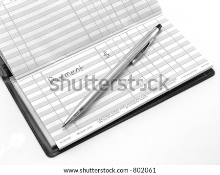 Notation of a payment within a checking account register - stock photo