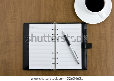 Note and coffee - stock photo