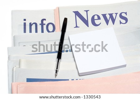 Note and pen, over stacked newspapers on white background - stock photo