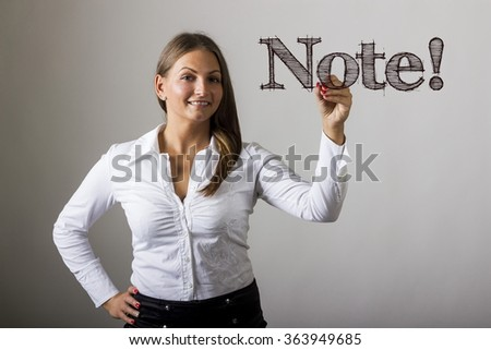 Note! - Beautiful girl writing on transparent surface - horizontal image