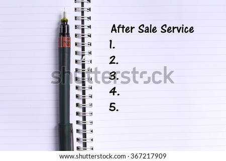 note book and a pen with AFTER SALE SERVICE word. Selective focus,shallow depth of field. - stock photo