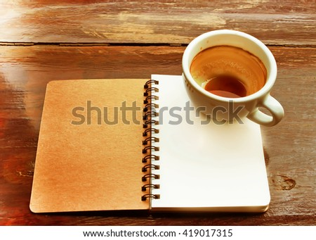Note book in coffee shop.soft blur.Vintage color effect added
