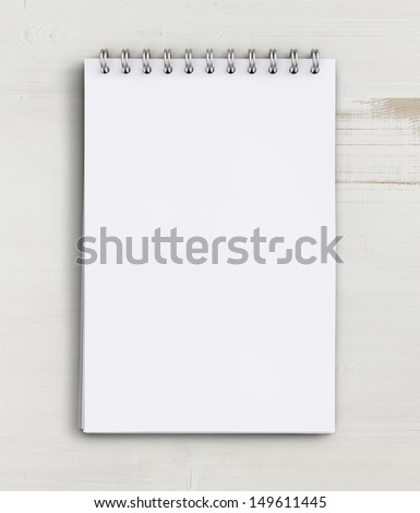 note book on a wooden table - stock photo