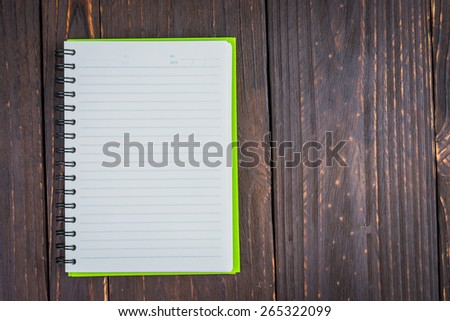 Note book on wooden background - vintage effect style picture