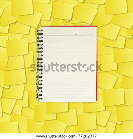 note book on yellow note paper - stock photo