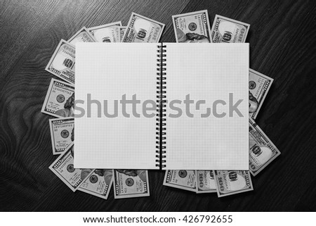 note book page and money, a place for records, business plan, new hundred-dollar bil face, copyspace, earnings on the Internet,  the money from the book, payment writer    - stock photo