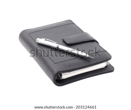 Note book with ballpoint pen on white background - stock photo
