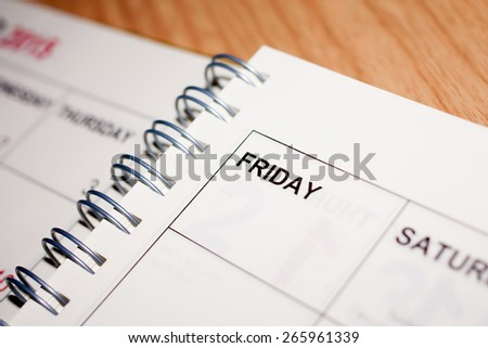 Note book with Friday word - stock photo