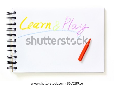 note book with learn and play text over white background - stock photo