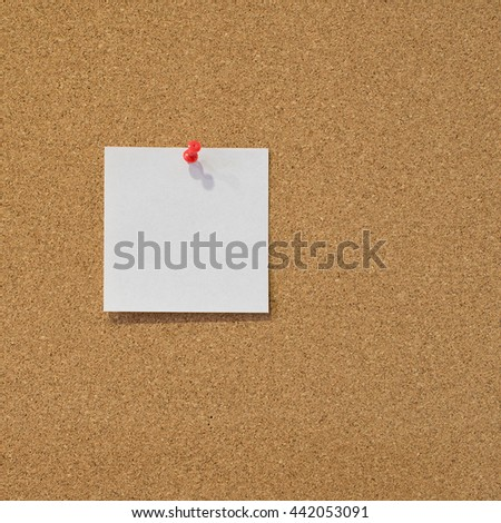 Note card posted on a cork board with red tack pin.