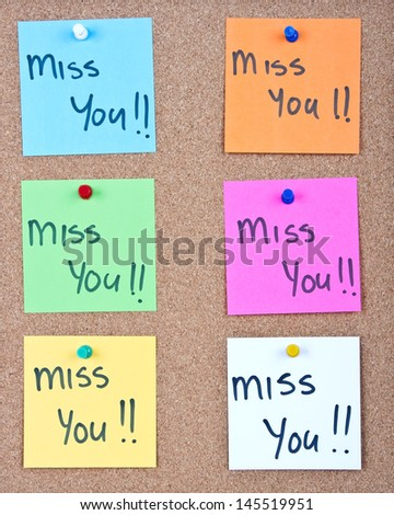 note collage with miss you messages on cork - stock photo
