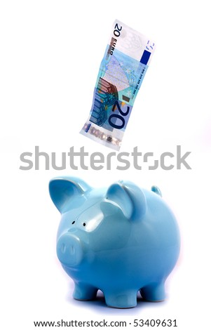 Note Falling into Blue Piggy Bank on White Background - stock photo