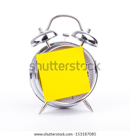 Note on clock with white background - stock photo