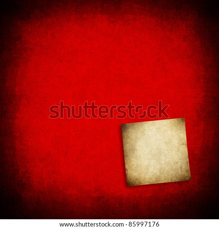 note on red background - stock photo
