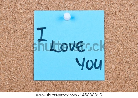 note on wood in blue with I love you - stock photo