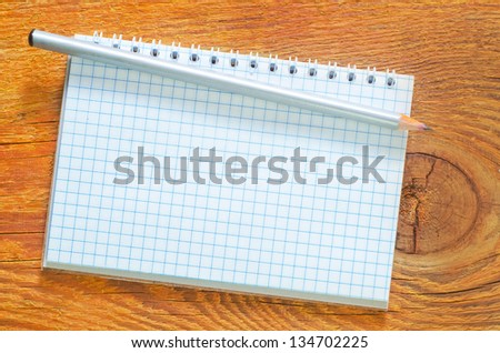 note on wooden background - stock photo