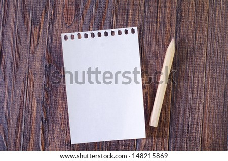 note on wooden board - stock photo