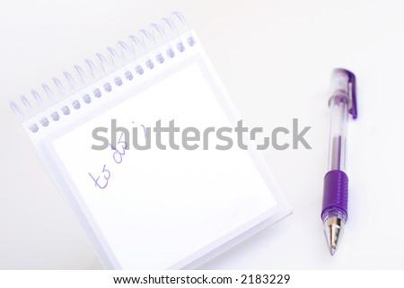 "note pad and purple pen with handwriting ""to do"""