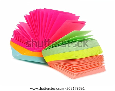 Note pad of sticky notes open like an fan isolated on white - stock photo
