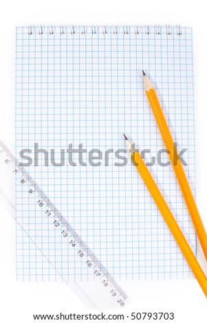 note pad straightedge and two pencils - stock photo