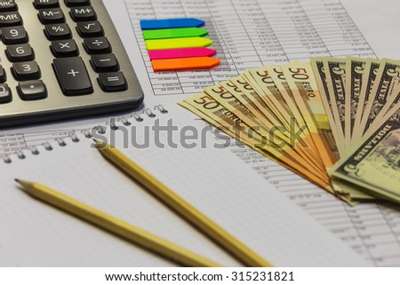 Note pad with pen, calculator and cash