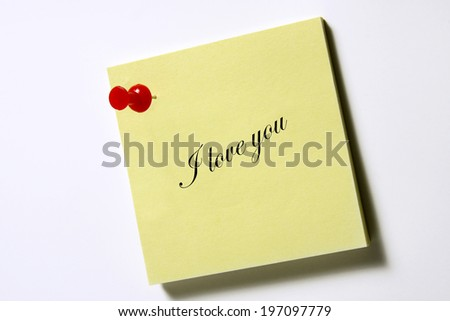 note pad with the words: I love you - stock photo