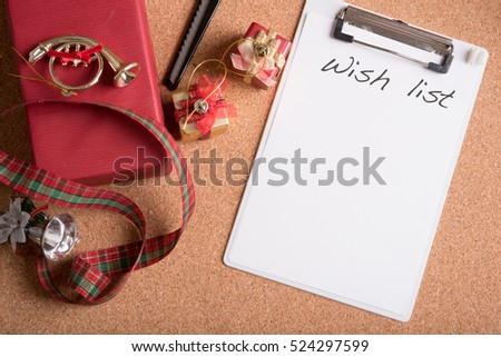 note pad with word wish list with holiday decoration on wood table